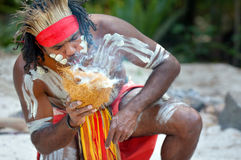 Aboriginal culture show in Queensland Australia. Portrait of one Yugambeh Aboriginal warrior demonstrate fire making craft during Aboriginal culture show in Royalty Free Stock Photos
