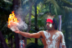 Aboriginal culture show in Queensland Australia. Portrait of one Yugambeh Aboriginal warrior demonstrate fire making craft during Aboriginal culture show in Stock Photos