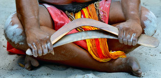 Aboriginal culture show in Queensland Australia. Yugambeh Aboriginal man sit and holds boomerangs during Aboriginal culture show in Queensland, Australia stock photo
