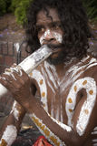 Aboriginal and didgeridoo Stock Image