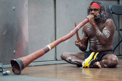 Aboriginal Didgeridoo Player. From the group Nunukul Yuggera Aboriginal Dancers performing on Queen Street Mall, Brisbane, 12 February 2012, during an Royalty Free Stock Photo