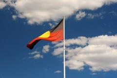 Aboriginal flag. Over the blue sky Stock Image