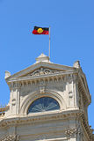 The Aboriginal flag being flown atop a town hall Stock Photography