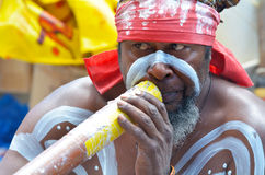 Aboriginal Indigenous Australian man play on Didgeridoo in Sydne. SYDNEY - OCT 19 2016:Aboriginal Indigenous Australian man play on Didgeridoo, a wind instrument Stock Photos