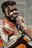 Aboriginal Man Playing Didgeridoo. Aboriginal man performing for passing tourists, Australia, Melbourne Stock Photo