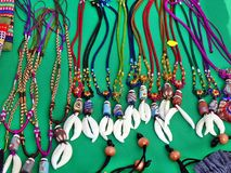 Aboriginal Necklaces with Animal Teeth. Aboriginal handmade jewelry and necklaces with colorful glass beads and animal teeth for sale at a market Stock Image