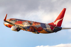 Aboriginal painted Qantas Boeing 737-838 VH-VXB `Yananyi Dreaming` departing Melbourne International Airport. royalty free stock photos