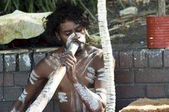 Australian Aborigine playing Digerridoo stock image