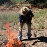Aboriginal setting a fire royalty free stock image