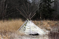 Aboriginal Tee-Pee. A tee-pee sits abandoned in the middle of a field of winter grass Stock Photo