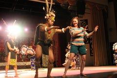 Aboriginal Warrior invite visitor dance togather. At cultural village sarawak Stock Images