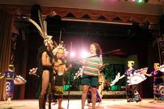 Aboriginal Warrior invite visitor dance togather. At cultural village sarawak Stock Photo