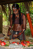 Aboriginal Woman. Unidentified aboriginal woman with digeridoo sorting fruits. Photo taken June 2, 2009 in Cairns stock image