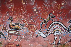 Aborigine art on wood. A traditional Aborigine artwork painted on a peace of old wood Stock Image