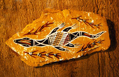 Aborigine drawing, australia tribal art. An image of a piece of abstract Australian aboriginal art, a swimming lizard or crocodile with patterned back Royalty Free Stock Image