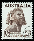 Aborigine Man Postage Stamp. AUSTRALIA - CIRCA 1970: A postage stamp printed in the Australia showing an Aborigine Man, circa 1970 vector illustration