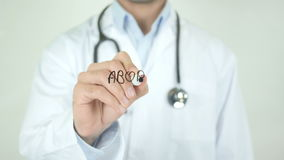 Abortion, Doctor Writing on Transparent Screen. Man writing stock footage