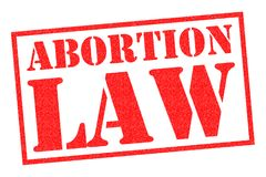 ABORTION LAW Rubber stamp. ABORTION LAW red rubber stamp over a white background stock illustration