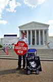 Abortion Protester at Supreme Court. WASHINGTON, DC - MAY 14: An anti-abortion protester holds a stop sign and the Ten Commandments on the sidewalk in front of royalty free stock image