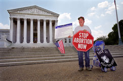 Abortion Protester at Supreme Court. WASHINGTON, DC - MAY 14: An anti-abortion protester holds a stop sign and the Ten Commandments on the sidewalk in front of Stock Images