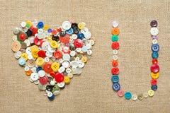 abotona el fondo del corazón Día de tarjeta del día de San Valentín Fotografía de archivo