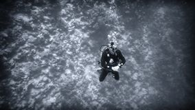 Above the abyss, a diver under water royalty free stock photo