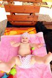 Expressive baby. From above adorable expressive baby looking at camera. Wide angle shot stock image