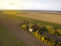 Above agricultural fields in Autumn Sunset. Late afternoon above abandoned ranch in the agricultural fields Stock Photos