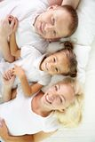 Lying on bed Royalty Free Stock Image