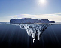 Above and below water view of icebergs Royalty Free Stock Image