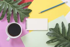 Above blank to do list notebook with leaf and coffee cup. On color design background Stock Photo