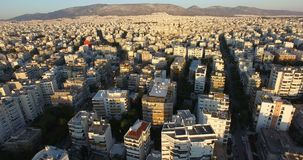 Above City 5. Flying above a city full of buildings and apartment blocks stock footage