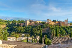 The Alhambra complex of palaces and gardens within the battlements of the alcazaba, Granada, Spain. Above the city of Granada sits the Alhambra - a complex of Royalty Free Stock Image