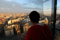 Above the city. Person watching Bucharest Romania cityscape from above the city Stock Photo