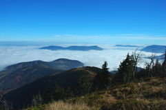 Above cloud. View at the mountain covered by cloud royalty free stock photo