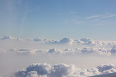 Above cloud blue sky background only Stock Photos