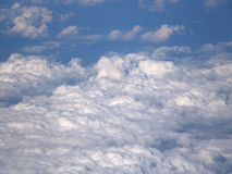 Background with clouds on blue sky, from the plane view royalty free stock photos