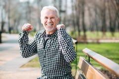 Energetic senior man rejoicing Royalty Free Stock Images