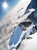 Above the clouds. A view of mountains and the sun Stock Image