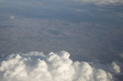Above The Clouds. Looking out of a plane window through the clouds over France Stock Photos