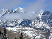 Above the Clouds. Clouds rolling in over the Colorado Rocky Mountains on a sunny day royalty free stock images