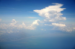 Above the clouds. Looking at clouds from a jet royalty free stock image