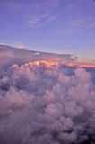 Above the clouds. View of sunset above the clouds from airplane Royalty Free Stock Images