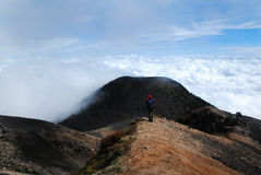 Above the Clouds. Standing above the clouds on Acatanango Volcano in Guatemala Stock Photo