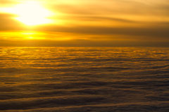 Above the clouds. Sunset view flying above the clouds Stock Photo