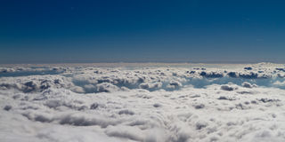 Above the clouds. Panorama view from Lomnicky Peak, High Tatras, Slovakia Royalty Free Stock Photo