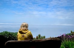 Above the Clouds. Sitting on a bench watching the clouds Royalty Free Stock Image