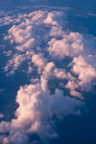 Above the clouds. Image taken from a plane, while rising above the clouds on a sunny autumn afternoon stock images
