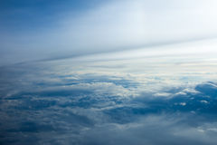 Above the clouds. View from aircraft window - flying above the clouds Royalty Free Stock Photo