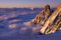 Above the clouds. Spring in the Alps Stock Photography